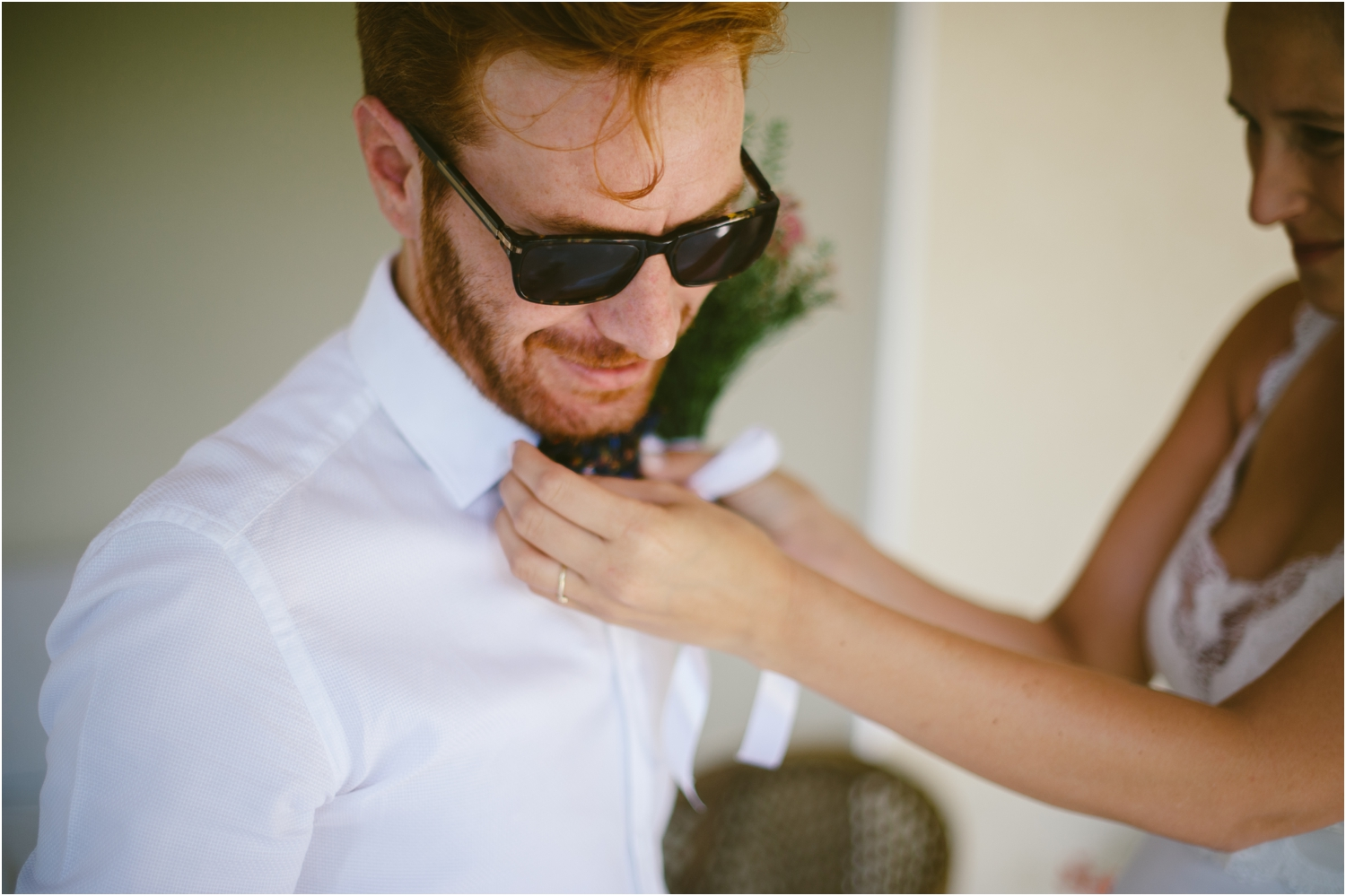 bride fixing groom's bow-tie