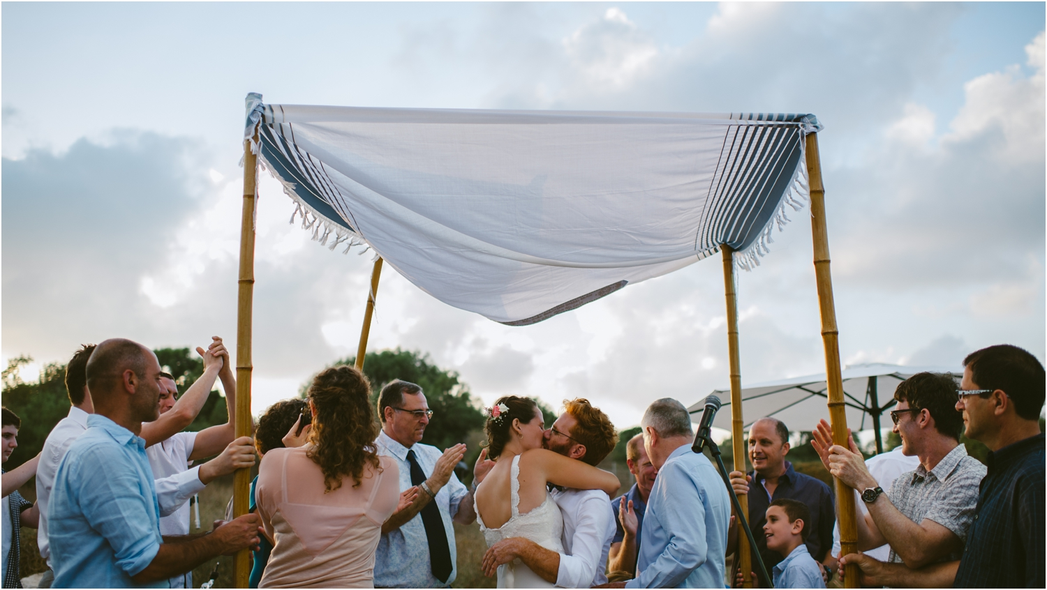 couple kissing in chuppah