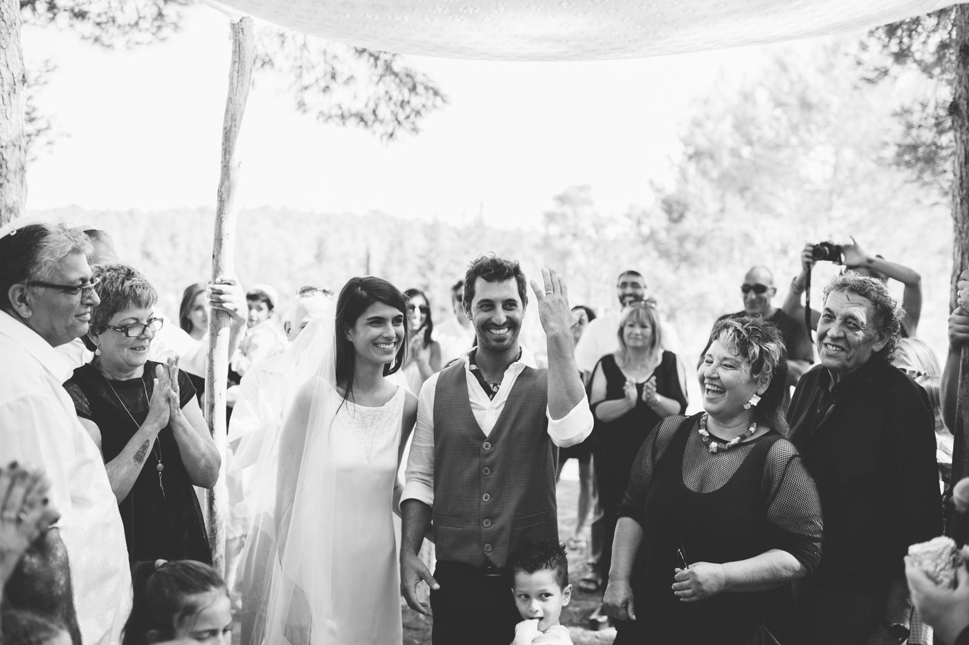 groom puts on wedding band