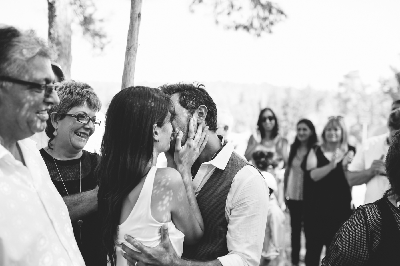 bride and groom kissing in chuppah
