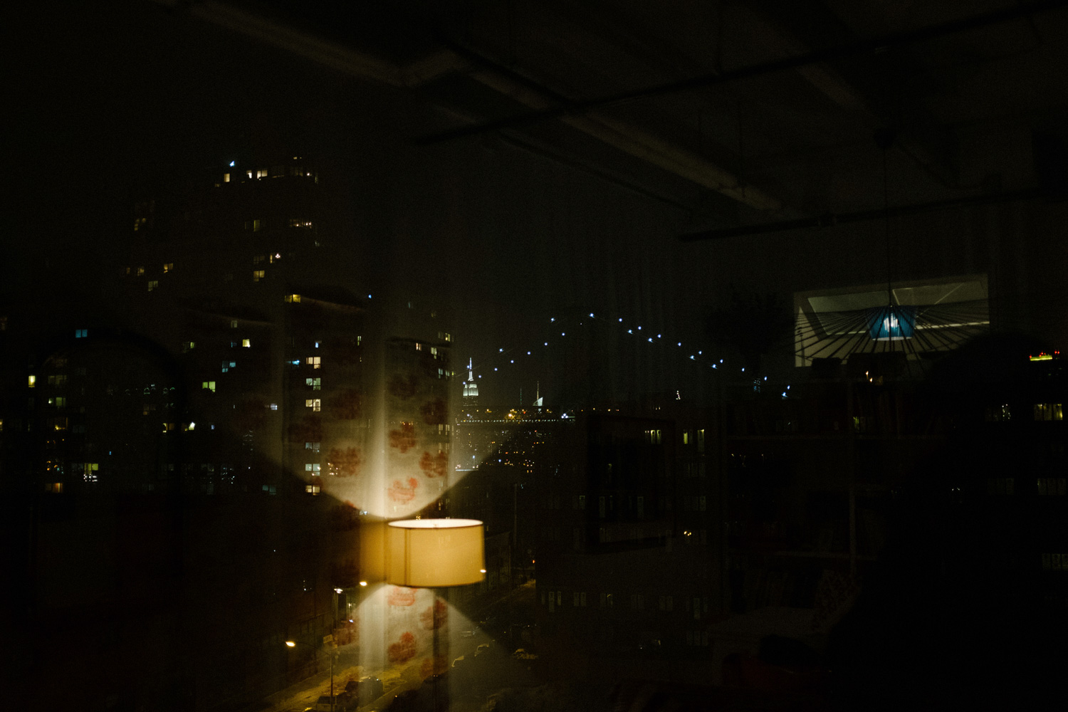window reflection with Manhattan in the distance