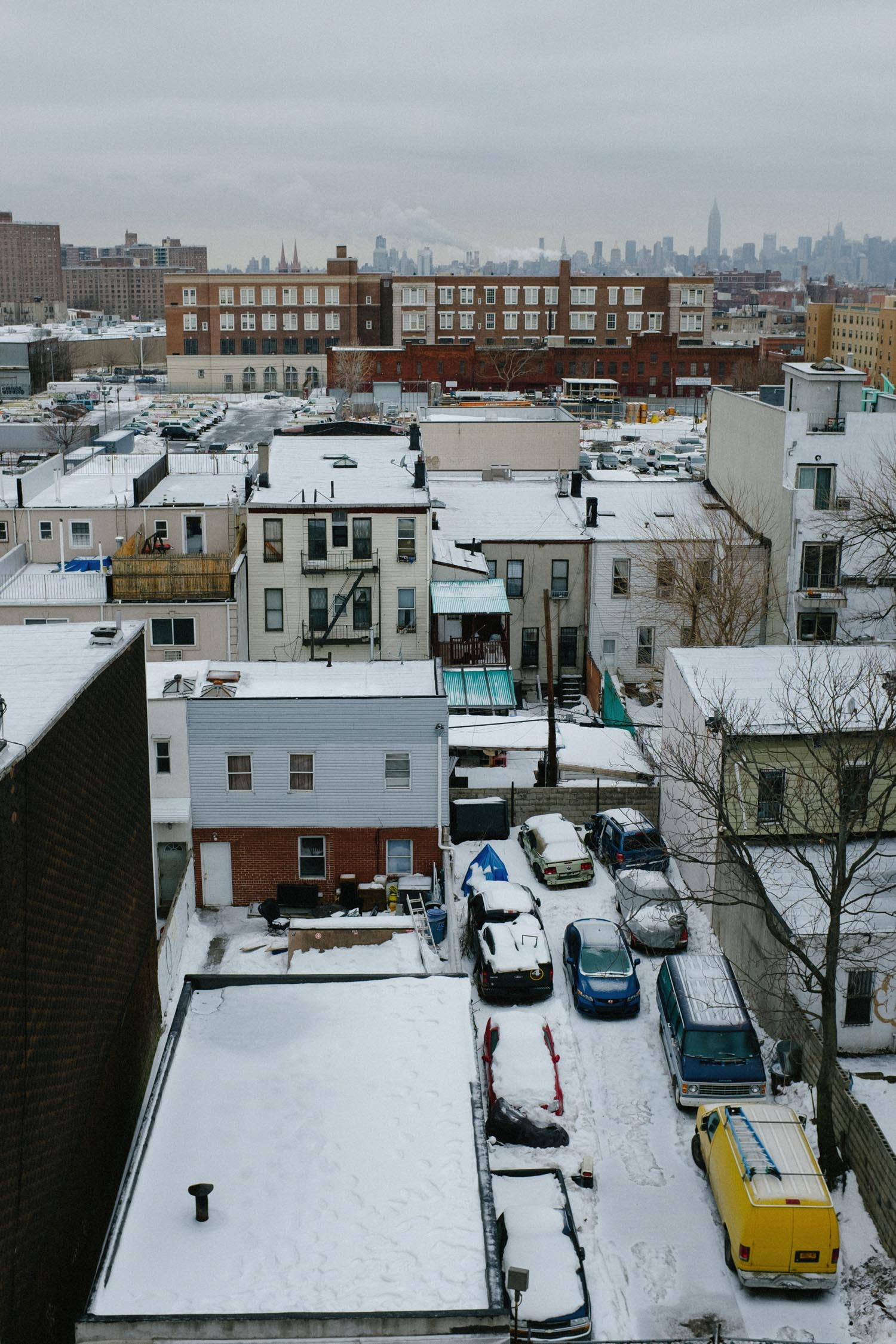 snowy views of manhattan from Brooklyn rooftop