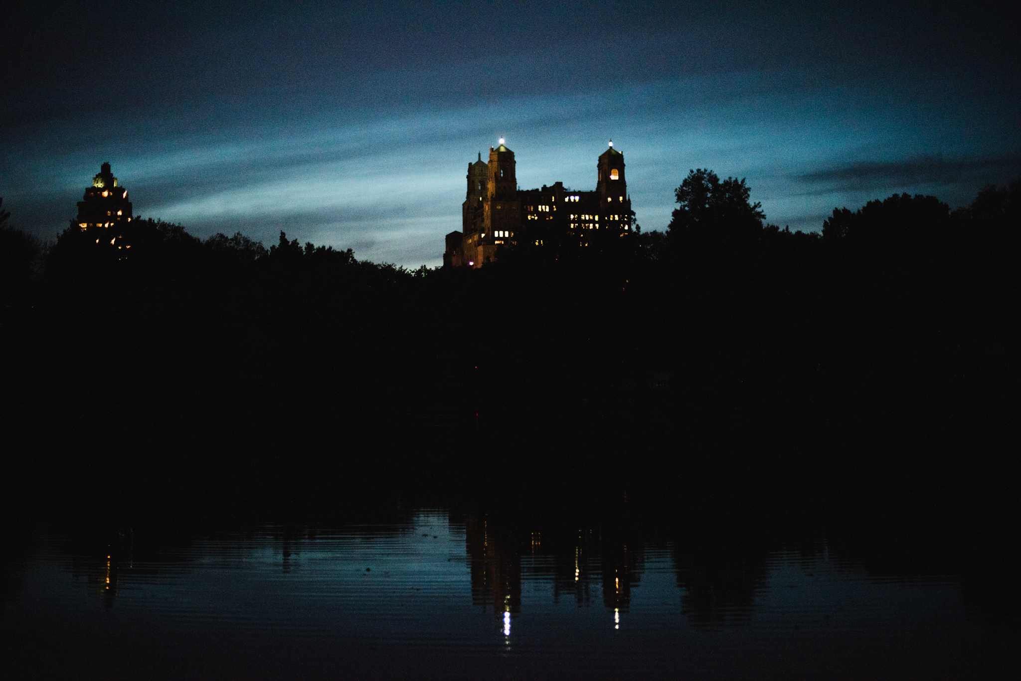 twilight view of building and lake in central park
