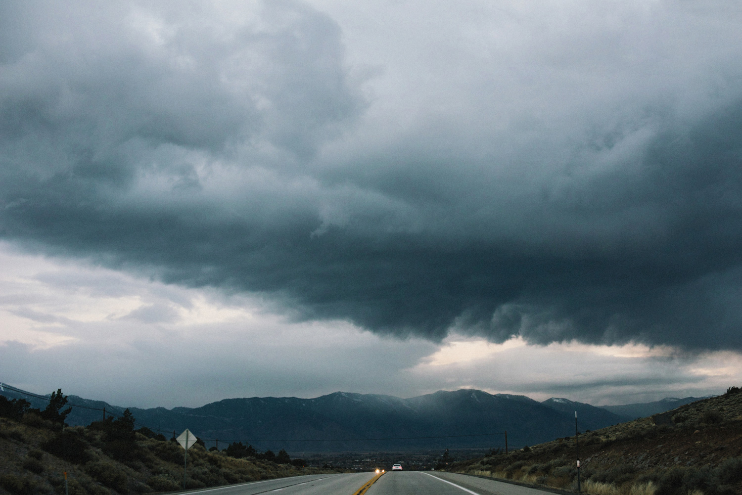 road and stormy skies in Yosemite park