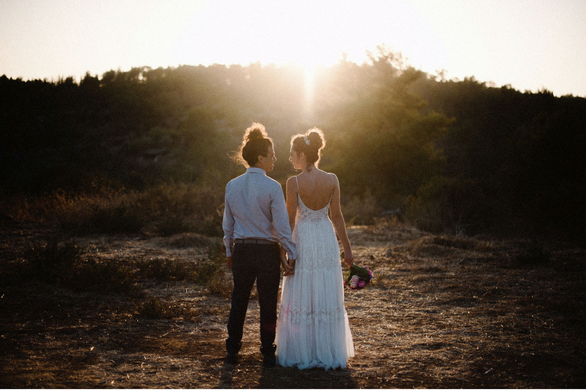 bride and groom sun portrait