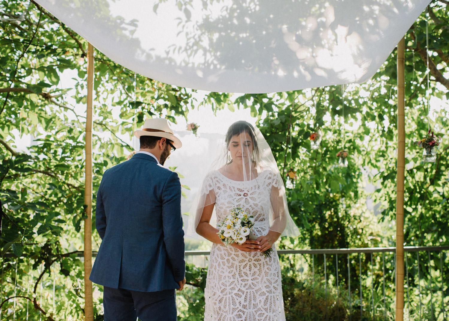 groom surrounding bride in chuppa