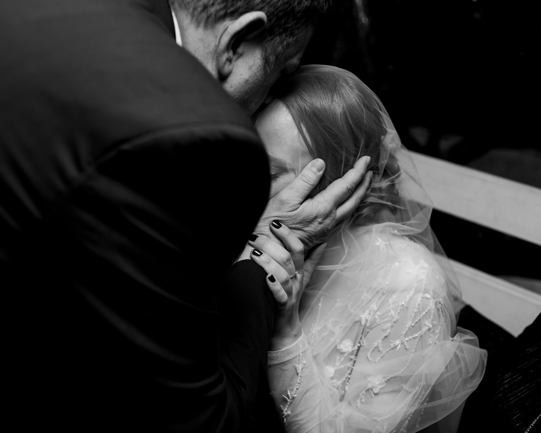 father of the bride kissing bride