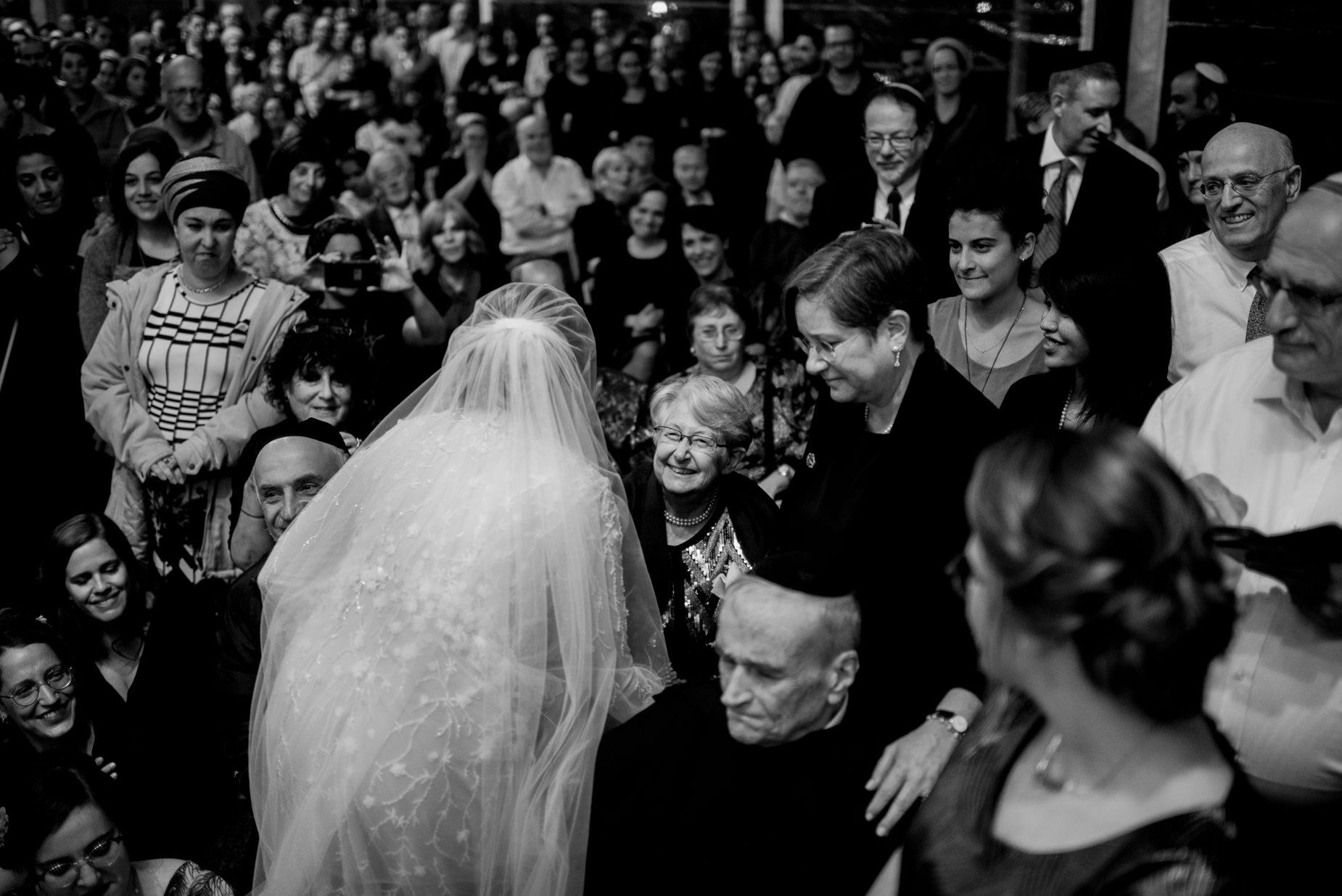 bride welcoming guests