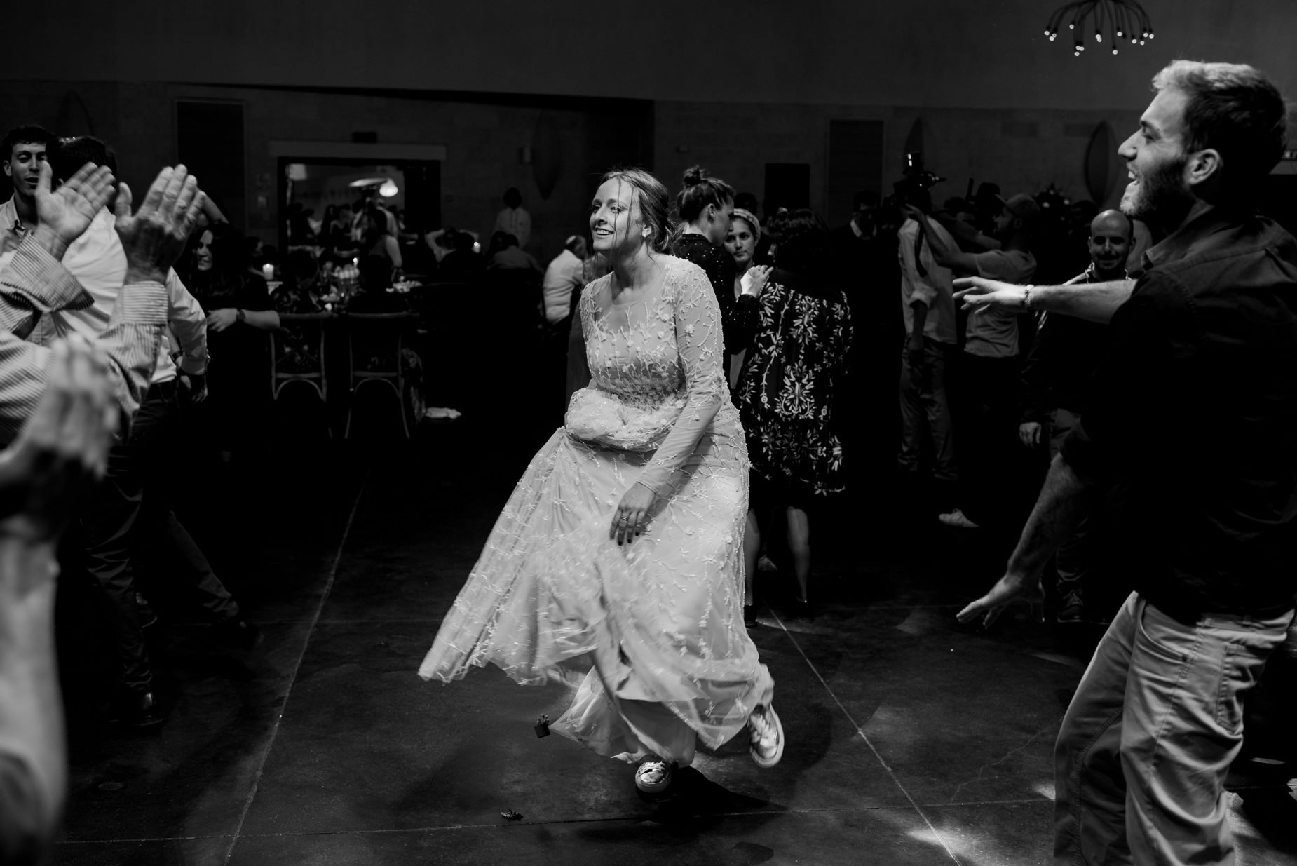Jewish bride dancing during reception